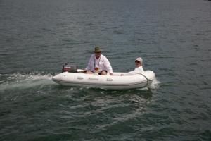 Chuck and Mavis in the dinghy